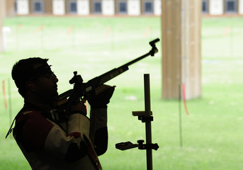 India's Narang checks out his equipment for the men's 10 m air rifle event ahead of the Beijing 2008 Olympic Games