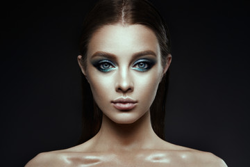 Fashion model Woman with fantasy make up. Long blowing brown hair. Fantasy Girl. Mermaid.