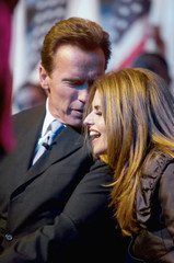 California Gov. Arnold Schwarzenegger talks to first lady Maria Shriver at his inauguration in Sacramento