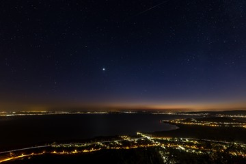 Starry sky at night over the lake Balaton in Hungary