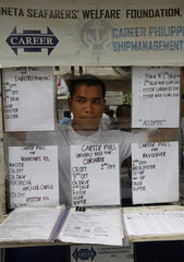 Recruiter of seafarers waits at his booth in Manila