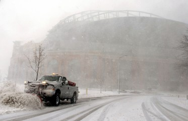 A snow plow is used to clear access roads to Miller Park in Milwaukee, Wisconsin