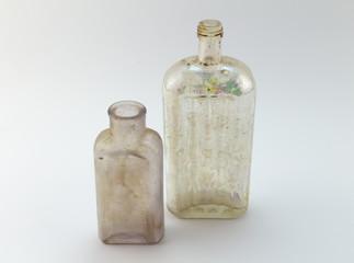 Old medicine bottles on white background