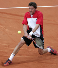 SAFIN OF RUSSIA RETURNS A BACKHAND DURING HIS MATCH AGAINST STARACE OF ITALY IN THE FRENCH OPEN ...