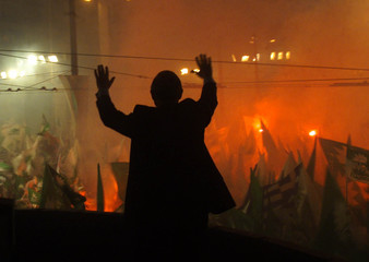 Greek Prime Minister and leader of the socialist PASOK party, Costas Simitis waves to thousands of s..
