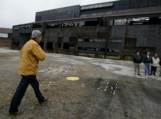 JOHN KERRY WALKS TOWARDS STEELWORKERS WAITING OUTSIDE CLOSED AND ABANDONED OHIO STEEL MILL.