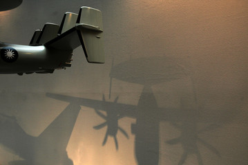 A shadow of a model of the E-2T Hawkeye 2000 is cast on a wall at a preview session of the Aerospace and Defence Technology Exhibition in Taipei