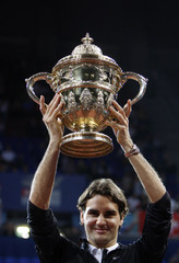 Switzerland's Federer celebrates holds his trophy after his victory over Argentina's Nalbandian in their final match at the Swiss Indoors tennis tournament in Basel