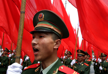 Chinese soldiers march in a parade to mark the 50th anniversary of the founding of the provincial government in Duyun