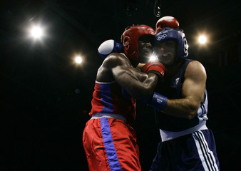 Pavlidis of Greece and Mabika of Gabon fight during Olympic boxing bout in Athens.
