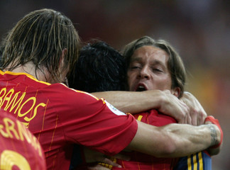 Spain's Raul celebrates his goal against Tunisia with team mates in Stuttgart