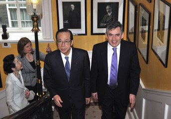 Britain's Prime Minister Gordon Brown walks up the staircase in 10 Downing Street with his Japanese counterpart Yasuo Fukuda, London