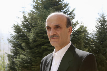 Samir Geagea, former Christian militia chief, poses outside his home in the Cedars in northern Lebanon