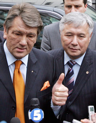 Ukrainian President Yushchenko and Prime Minister Yekhanurov talk to reporters after a tender to sell the country's largest steel mill Kryvorizhstal in Kiev