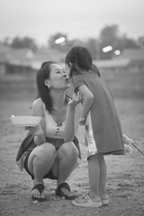I love you mom,daughter and mother kissing with love.Black and White style.