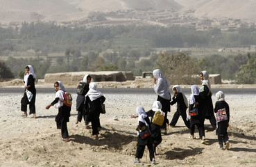 Afghan girls return from school, south of Kunduz