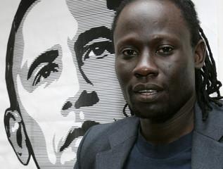 Kenyan musician Makadem poses in front of a poster of U.S. Democratic presidential nominee Senator Obama in Nairobi