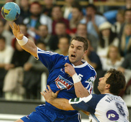 GILLE OF FRANCE THROWS PAST BEDEKOVIC OF SLOVENIA DURING EUROPEAN HANDBALL CHAMPIONSHIPS.