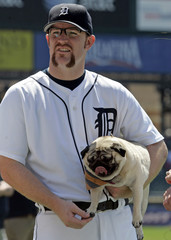 Detroit Tigers pitcher Robertson stands on field with his dog Gracie before start of their MLB interleague game against St Louis Cardinals in Detroit