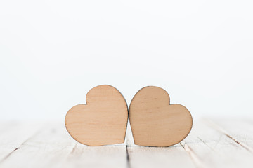 Close-up view of decorative wooden hearts symbols on white