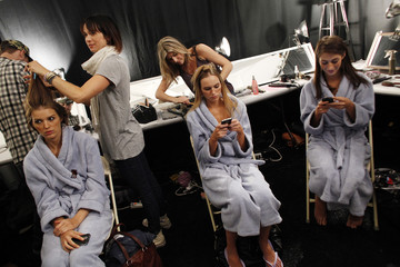 Models are made up before the Gottex Spring 2010 collection during New York Fashion Week
