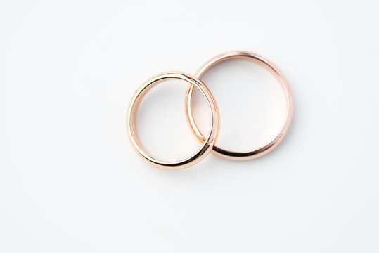 two golden wedding rings isolated on white, wedding rings background concept