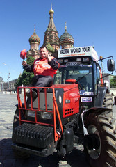 Christian Hurault of France poses for a picture on his tractor in front of St.Basil's cathedral in M..