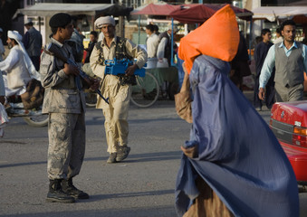 A member of the Afghan special police force monitors an area in Herat