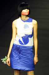 A MODEL DISPLAYS A CREATION BY NOTHING NOTHING DURING LONDON FASHION WEEK.