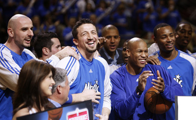 Orlando Magic forward Hedo Turkoglu of Turkey is joined by members of his team as he was presented with the NBA most improved player award in Orlando