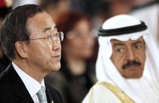 UN Secretary General Ban listens to speech as Bahrain's PM Sheikh Khalifa looks on at the UN Conference in Bahrain