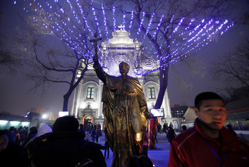 Worshippers gather outside a Catholic church for Christmas mass in Beijing