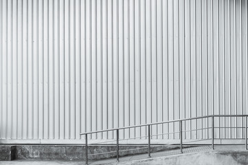 industrial wall background. factory metal sheet with slope path black and white art tone.