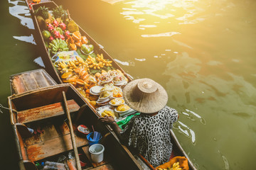 Fruit boat sale at Damnoen Saduak floating market. Damnoen Saduak is a popular travel tourist destination.