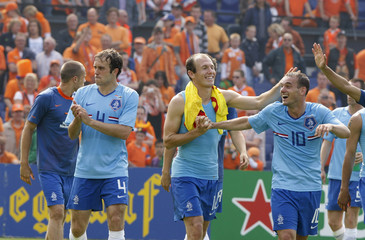 Players Mathijsen Robben and Sneijder of the Netherlands acknowledge their supporters after a soccer friendly against Wales in preparation for Euro 2008 in Rotterdam