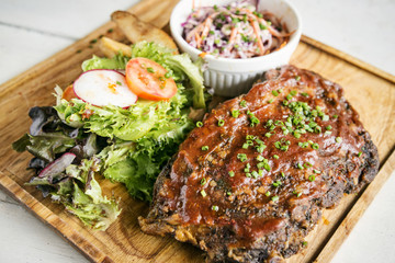 pork bbq ribs with  coleslaw and salad