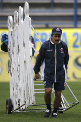 Colombia's head coach Jorge Luis Pinto carries human silhouettes for free kick training in Santiago