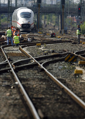 Workers work on the tracks outside the main station in Frankfurt
