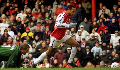 ARSENAL'S HENRY BEATS LEICESTER CITY'S FLOWERS TO SCORE HIS HATRICK AT HIGHBURY.