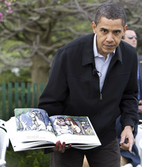 U.S. President Barack Obama reads story during 2009 White House Easter Egg Roll at the White House
