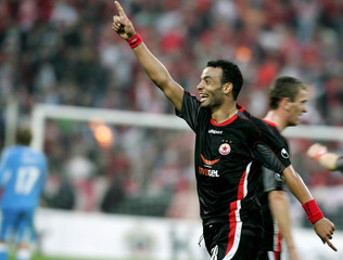 Hdiouad from CSKA Sofia celebrates his team's victory against Bayer at a UEFA Cup match in Sofia