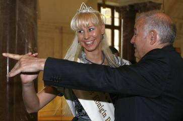 Bavarian state premier Beckstein dances with the folk festival queen of Pfaffenhofen Konn during a reception of Bavarian product queens in Munich