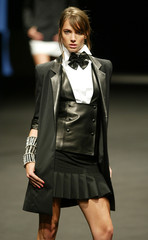 A MODEL PRESENTS A CREATION BY GERMAN DESIGNER KARL LAGERFELD AT THEEND OF HIS SPRING-SUMMER ...
