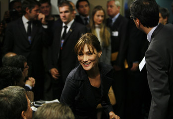 Carla Bruni-Sarkozy takes her seat at a news conference for her husband, France's President Nicolas Sarkozy, during the United Nations General Assembly at U.N. Headquarters