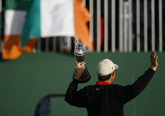 Ireland's Padraig Harrington holds up the Claret Jug trophy after winning the 2007 British Open Golf Championship tournament in Carnoustie
