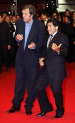 "Former soccer star Maradona and direcctor Kusturica joke before screening of ""Maradona by Kusturica"" in Cannes"