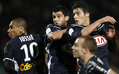 Bordeaux's Jussie, Menegazzo and Gourcuff fight for the ball during a free kick in their French Ligue 1 soccer match against Lille in Bordeaux