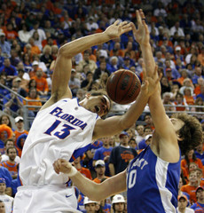 University of Florida Noah is blocked under the basket for the shot by University of Kentucky Obrzut in first period NCAA basketball game in Gainesville
