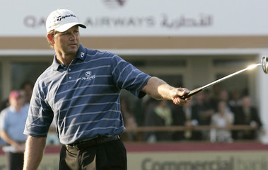 Retief Goosen of South Africa's celebrates after putting in the 18th green and winning the Qatar Masters golf tournament in Doha