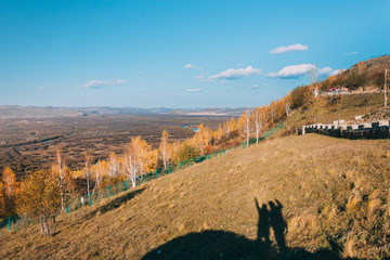 on a moutain of Inner Mongolia Hulun Buir River Genhe Wetland in Eergu'Na,in Autumn with yellow trees and blue sky